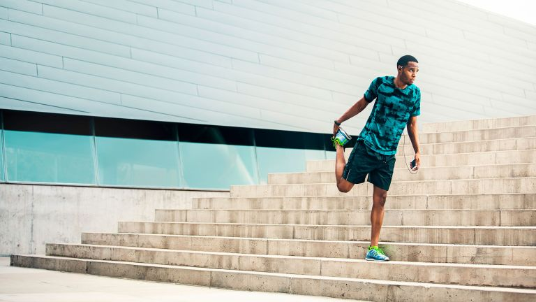 Man stretching his hip flexors before going running
