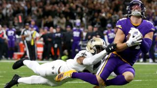 Adam Thielen #19 of the Minnesota Vikings catches a pass over Patrick Robinson #21 of the New Orleans Saints during the NFC Wild Card Playoff game at Mercedes Benz Superdome on Jan. 5, 2020 in New Orleans, Louisiana.