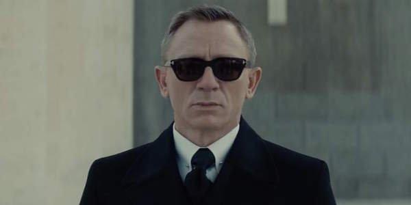Daniel Craig wearing sunglasses as James Bond in Spectre