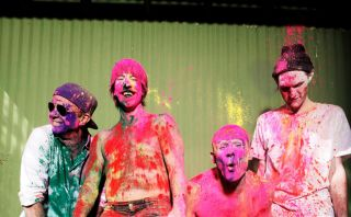 A promotional photo of the Red Hot Chili Peppers