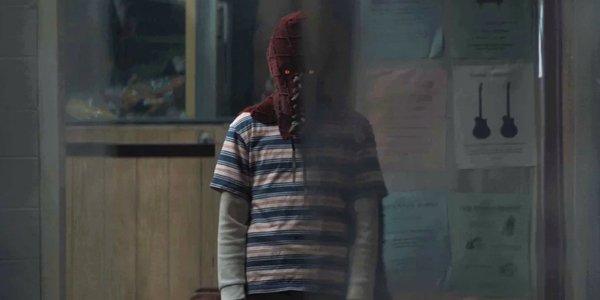 Brandon Breyer in his mask in a diner in Brightburn