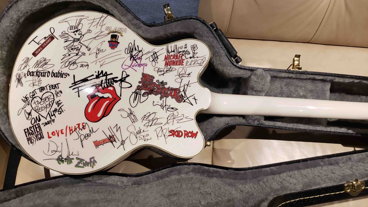 A guitar signed by Keith Richards, Slash and many more is up for auction to benefit New York Dolls' Sylvain Sylvain