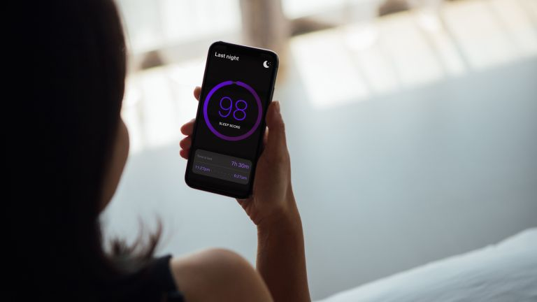 woman using one of best sleep apps on smartphone