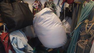 sleeping bag in storage cupboard