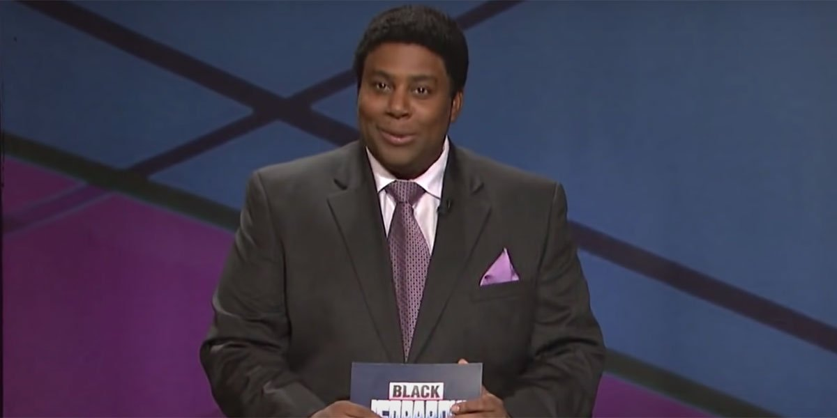 Kenan Thompson with note cards hosting Black Jeopardy on SNL