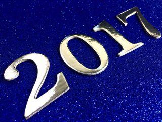 Silver 2017 on a festive blue glittery background