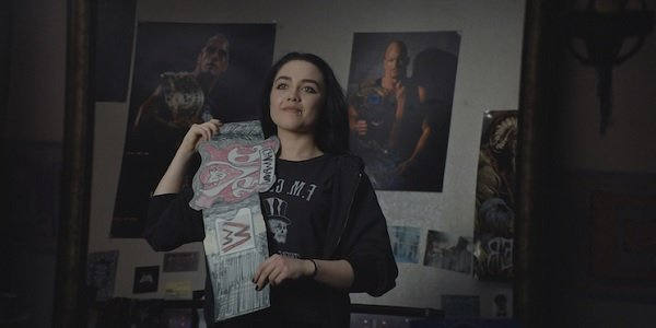 Fighting With My Family Florence Pugh stands with her cardboard championship belt in her bedroom