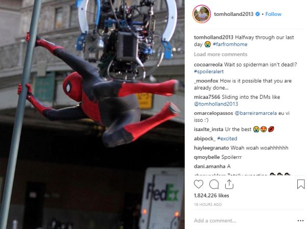 Spider-Man swinging on a bar, in set photo image