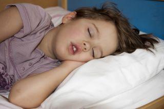 Girl sleeping in her bed