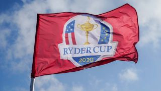 A red flag reading Ryder Cup 2020 and containing a picture of the Ryder Cup flanked by USA and Europe flags. The flag is pictured against a blue sky