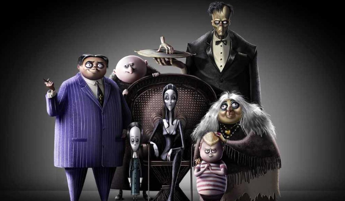 The Addams Family sitting in a portrait formation
