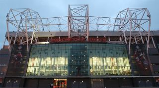 Old Trafford stadium at night