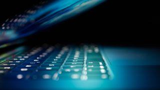 laptop keyboard lit by screen