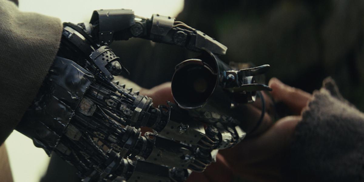 Rey handing Luke his lightsaber