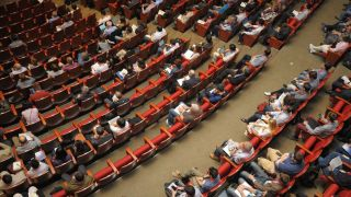 People sat at a conference event - solutions for event management