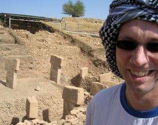 Professor Tristan Carter is shown alongside one of the stone rings at Gobekli Tepe in Turkey.