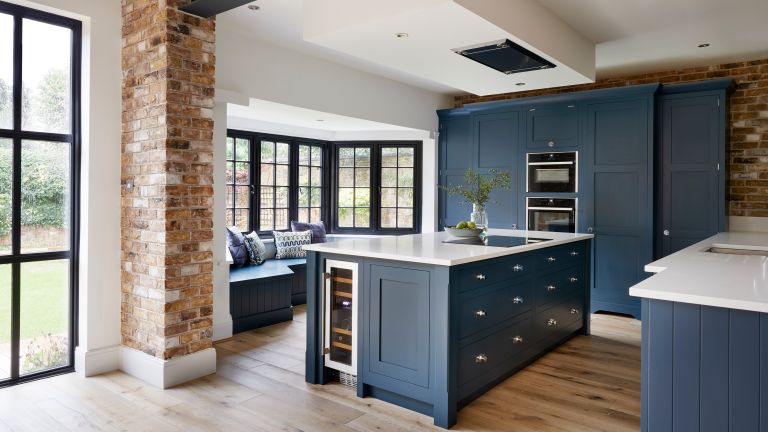Industrial design meets classical cabinetry in this kitchen
