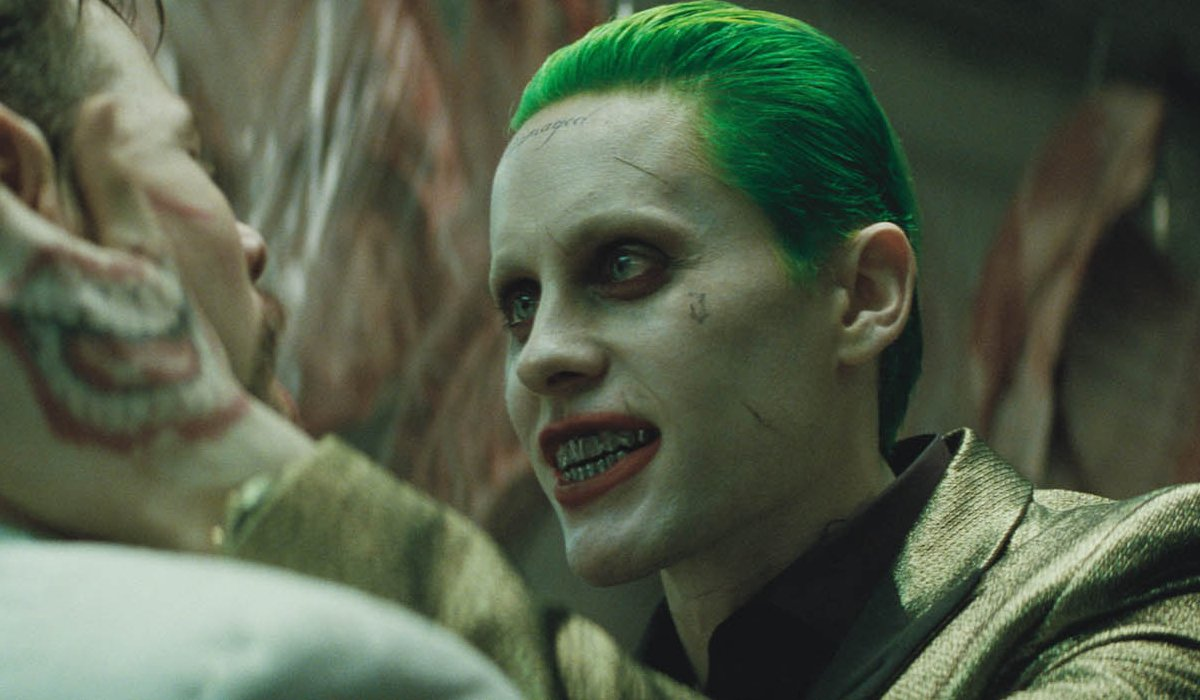Suicide Squad Joker interrogates a man close up