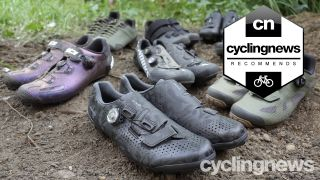 A collection of the best gravel bike shoes on test, all in pairs on a muddy floor