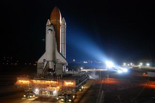 Space shuttle Discovery, bathed in Xenon lights, rolls out to Kennedy Space Center's Launch Pad 39A on Jan. 31, 2011.