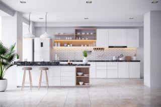 contemporary white kitchen with accent lighting