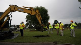 Archaeologists and observers watch during a test excavation of the 1921 Tulsa Race Massacre Graves at Oaklawn Cemetery in Tulsa, Oklahoma, on July 13, 2020.