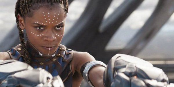 Black Panther Shuri standing with her gauntlets ready to fire