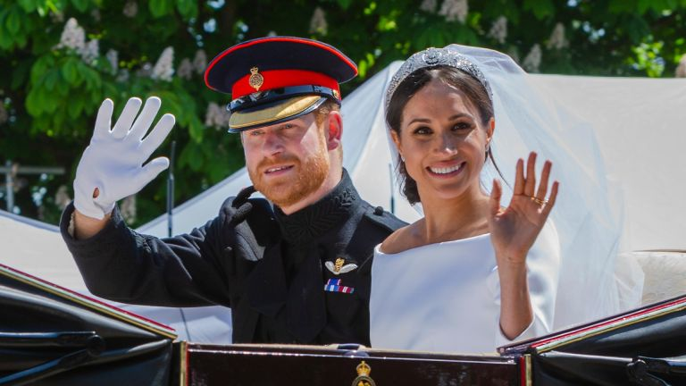 Prince Harry and Meghan Markle in the carriage after their wedding ceremony