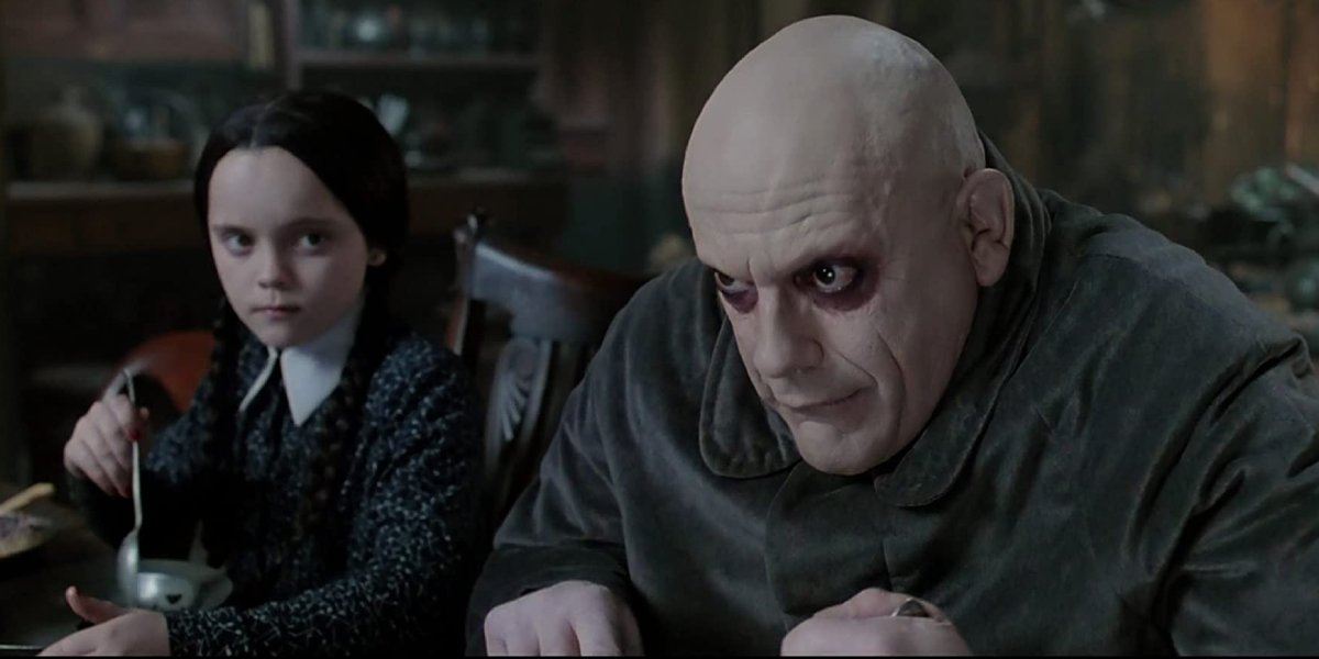 Christina Ricci and Christopher Lloyd in The Addams Family