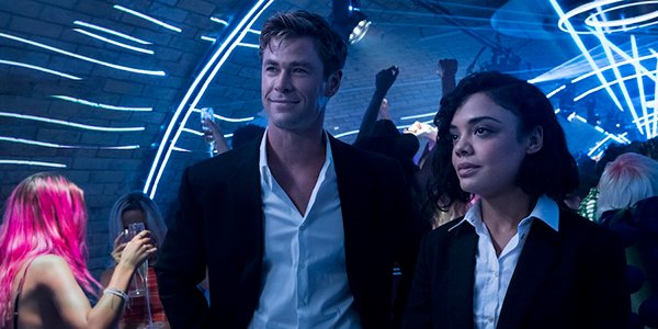 Chris Hemsworth and Tessa Thompson in a club in Men in Black: International