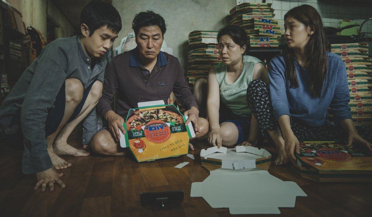 Parasite The Kim family huddled around pizza boxes