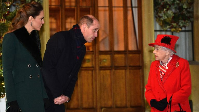 Queen Elizabeth II talks with the Duke and Duchess of Cambridge in the quadrangle at Windsor Castle to meet and thank members of the Salvation Army and local volunteers and key workers from organisations and charities in Berkshire, for the work they are doing to help others during the pandemic and over Christmas.