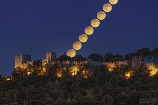 Harvest Moon moonrise over Sesimbra Castle, Portugal