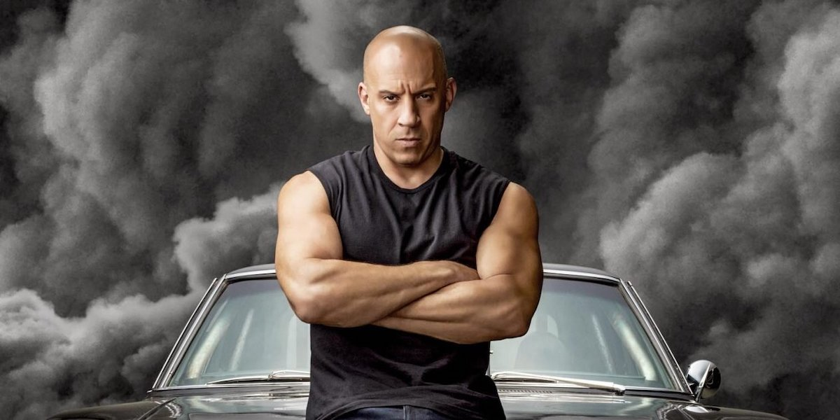 Vin Diesel standing in front of car in F9 poster