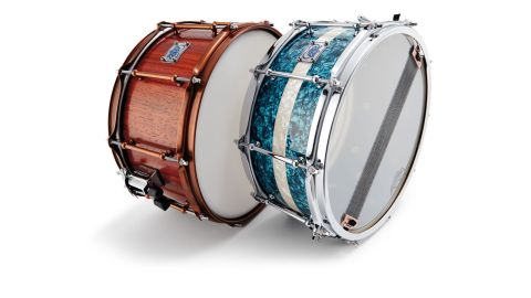 The drum (right) is wrapped in Teal Blue Pearl with an insert of off-white Marine Pearl
