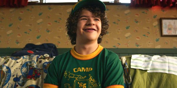 Dustin smiles in his camp shirt Stranger Things Season 3 Netflix