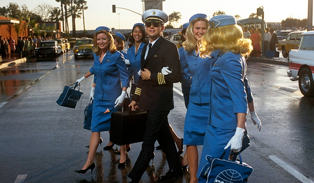 Catch Me If You Can Leonardo DiCaprio flanked by flight attendants in the street