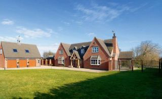 A large, steeply gabled family home with impressively low build costs