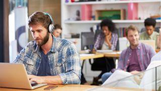 man working with headphones