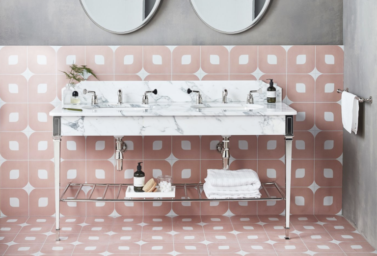 bathroom with pink tiles and marble vanity by drummonds
