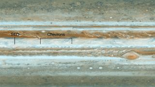 This view from NASA's Cassini spacecraft shows the path of one of Jupiter's jet streams, a line of V-shaped chevrons travels west to east just above Jupiter's Great Red Spot.