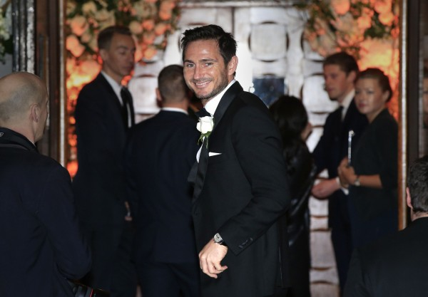 Frank Lampard waves as he arrives at the wedding