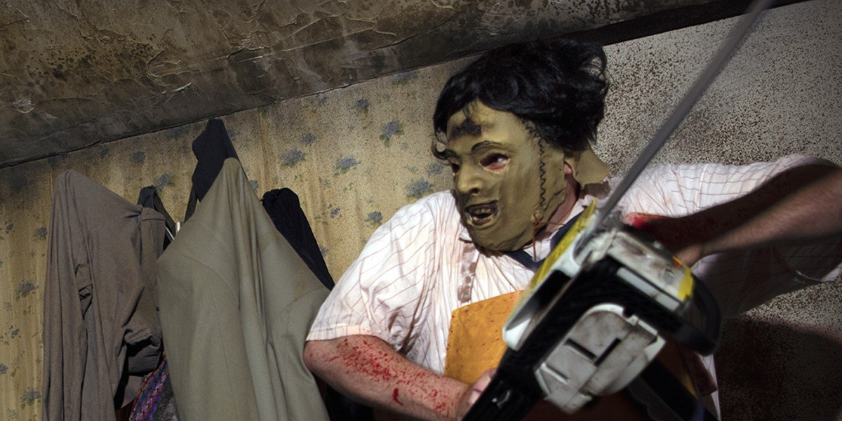leatherface with chainsaw in texas chainsaw massacre haunted maze at universal studios orlando halloween horror nights