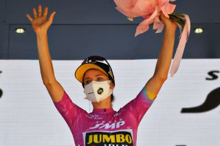 MORTEGLIANO ITALY JULY 09 Marianne Vos of Netherlands and Jumbo Visma Team Purple Points Jersey celebrates at podium during the 32nd Giro dItalia Internazionale Femminile 2021 Stage 8 a 1294km stage from San Vendemiano to Mortegliano Flowers GiroDonne UCIWWT on July 09 2021 in Mortegliano Italy Photo by Luc ClaessenGetty Images