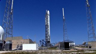 A SpaceX Falcon 9 rocket and Dragon cargo ship stand atop its Florida launch pad ahead of a planned April 14, 2014 launch to the International Space Station. The mission for NASA will launch from Cape Canaveral Air Force Station.
