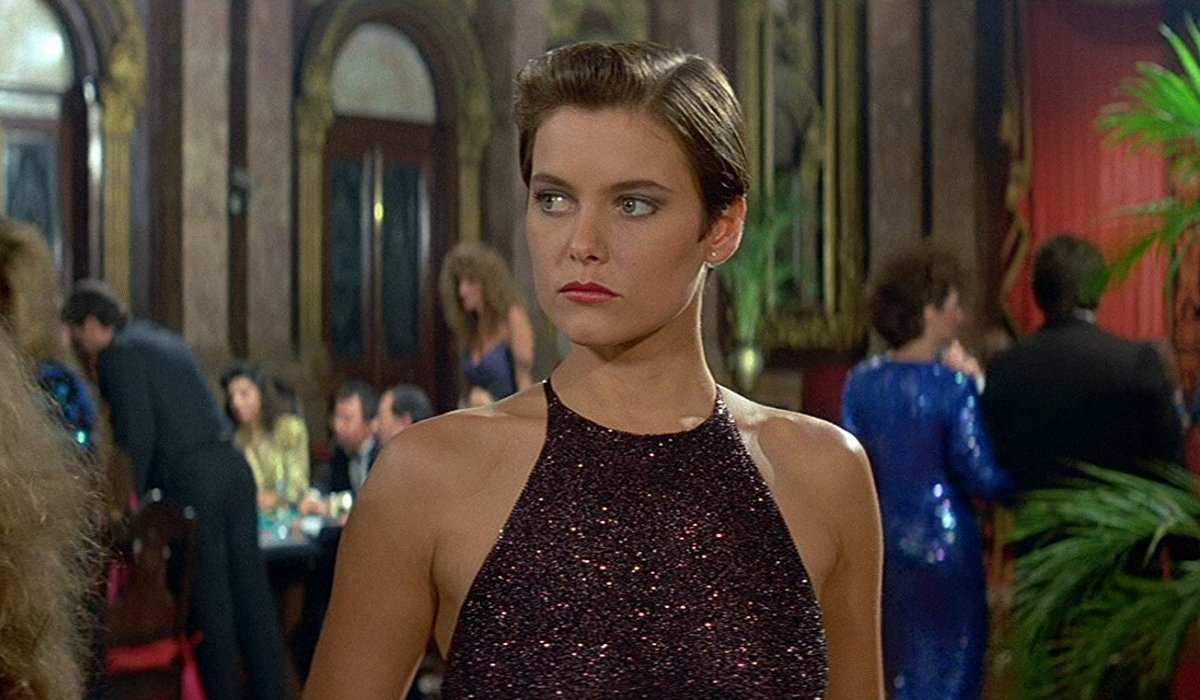 License to Kill Pam Bouvier in a dress at the casino