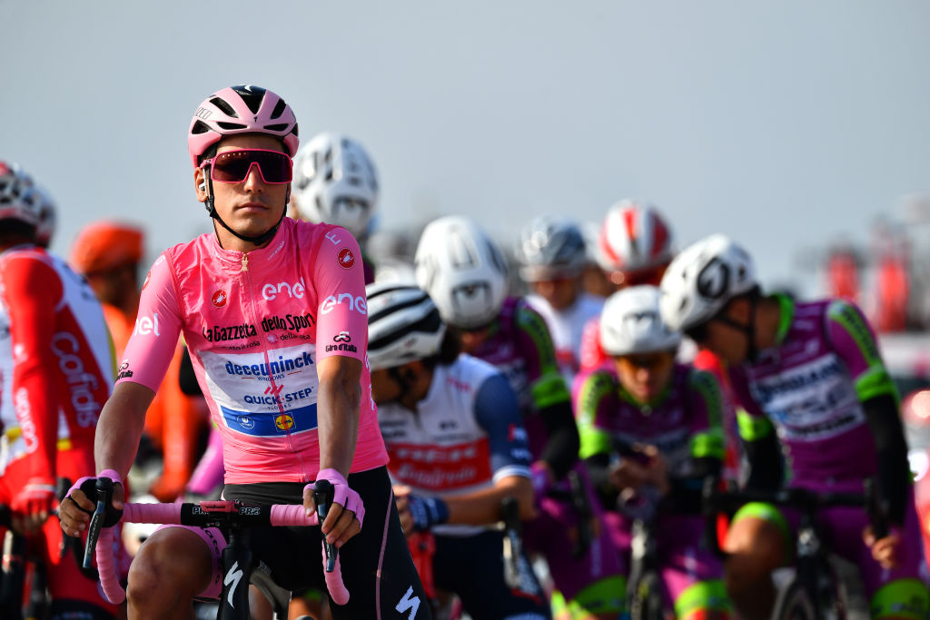 PIANCAVALLO ITALY OCTOBER 18 Start Joao Almeida of Portugal and Team Deceuninck QuickStep Pink Leader Jersey Base Aerea Rivolto Peloton during the 103rd Giro dItalia 2020 Stage 15 a 185km stage from Base Aerea Rivolto Frecce Tricolori to Piancavallo 1290m girodiitalia Giro on October 18 2020 in Piancavallo Italy Photo by Stuart FranklinGetty Images