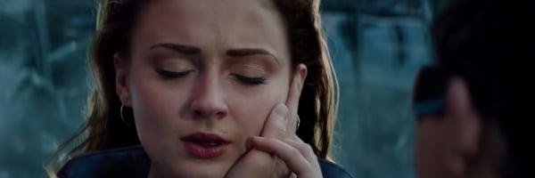 Dark Phoenix Jean holding Scott's hand against her face