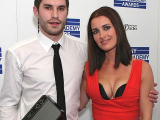 Kirsty Gallagher with some fella called 'Singing Henry' with a bit of a sweat on at the recent Sony Radio Awards bash