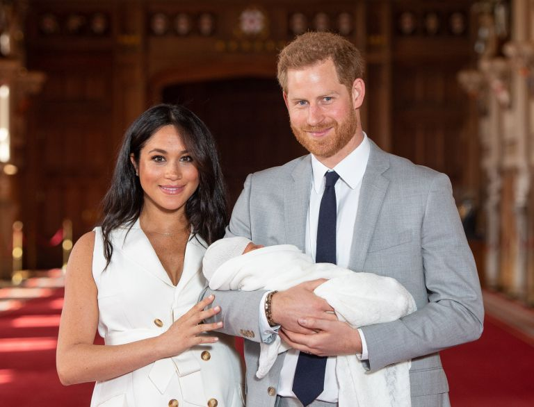 Prince Harry and Meghan Markle, Prince Harry, Duke of Sussex and Meghan, Duchess of Sussex, pose with their newborn son Archie Harrison Mountbatten-Windsor during a photocall in St George's Hall at Windsor Castle on May 8, 2019 in Windsor